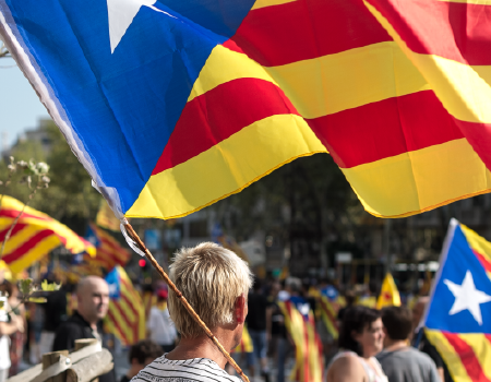 A man carrying a Catalan independence flag at a rally