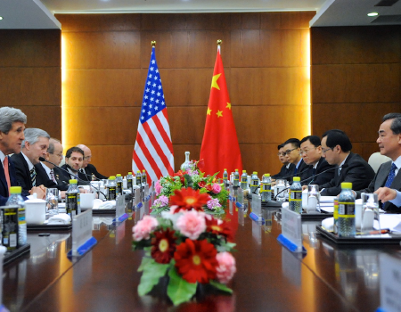 Top US and Chinese officials across from each other at a long table