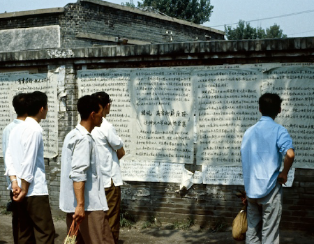 People look for names of dead & injured on a wall following Tiananmen Square massacre in 1989